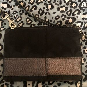Black Fabric Coach wristlet with silver stripe.